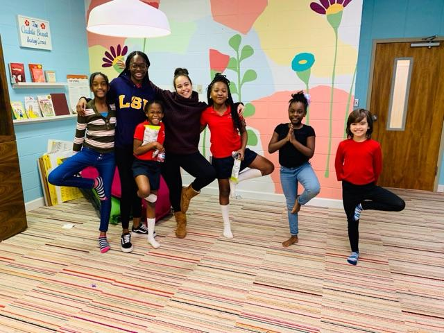 A photo of 2019 ASF Fellow Jessica McKenzie with some of her student participants at a Girls on the Run Birmingham session.
